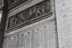 Names on the Arc de Triomphe. A list of names and depictions of angels and cherubs, engraved on the side of the Arc de Triomphe Stock Photos