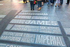 Names of Broadway theaters on the Times Square in New York City. New York City, USA - October 06, 2015: in the pavement embedded names of Broadway theaters royalty free stock images