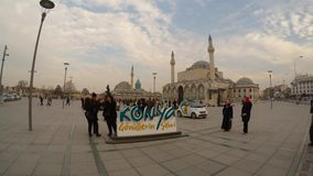 The names of the city of Konya in large letters on the square near Selimiye Mosque, Mevlana Museum. KONYA / TURKEY - 11.20.2016 central streets of the ancient stock video