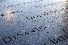 Names  at the 9/11 Memorials. NEW YORK, USA - September 29, 2017: Names of the victims at the National September 11 Memorial, in New York, USA Stock Photography