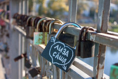 Names on the padlocks as a proof of love Royalty Free Stock Photo