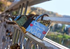 Names on the padlocks as a proof of love Royalty Free Stock Photos