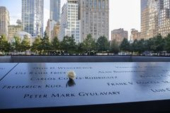 Names and a rose at the 9/11 Memorials. NEW YORK, USA - September 29, 2017: Names of the victims and a white rose at the National September 11 Memorial, in New Stock Photo