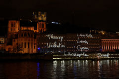 Names of victims on the walls. LYON, FRANCE, December 8, 2015 : With numerous small lights, the festival of lights 2015 pays tribute to the victims of the royalty free stock images