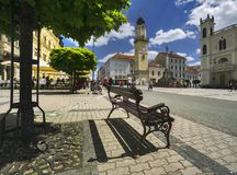 Namestie SNP square at Banska Bystrica. With bench and Clock Tower Stock Images