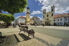 Namestie SNP square at Banska Bystrica. With bench, Clock Tower and St. Francis Xavier Cathedral of Stock Photography