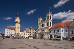 Namestie SNP square at Banska Bystrica. With the Clock Tower and Saint Francis Xavier Cathedral Stock Images