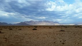 Namib Desert and mountains after rain. View of the Naukluft Mountains near Sossusvlei in Namibia and the Namib desert plains after rain Stock Photo