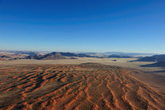 Namib Desert (Namibia). View over the Namib Desert from a balloon with the Naukluft Mountains in the Background (Namibia royalty free stock photos