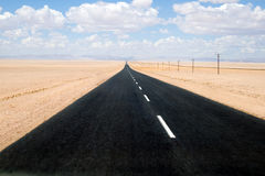 Namib Desert Road. Namib Desert - Road through desert of Namib in Namibia Stock Photos
