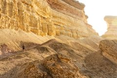 NAMIBE/ANGOLA 03NOV2018 - Girl descend a canyon mountain in the Namibe Desert. Africa. Angola royalty free stock photo