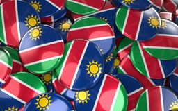 Namibia Badges Background - Pile of namibian Flag Buttons. 3D Rendering Royalty Free Stock Photography