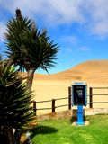Namibia, Blue Public Phone Booth in Desert royalty free stock photo