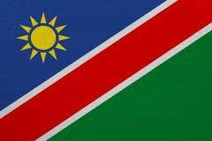 Namibia flag on canvas. Patriotic background. National flag of Namibia stock illustration
