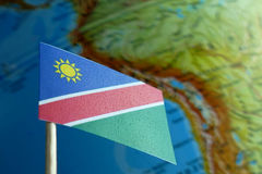 Namibia flag with a globe map as a background Royalty Free Stock Photos