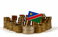 Namibia flag with stack of money coins Royalty Free Stock Photos