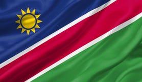 Namibia flagga som vinkar med vinden, illustration 3D Royaltyfria Bilder