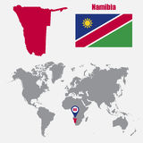 Namibia map on a world map with flag and map pointer. Vector illustration Stock Photo