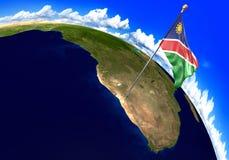 Namibia nationsflagga som markerar landsläget på världskarta 3D tolkning, delar av denna bild som möbleras av NASA Royaltyfri Foto