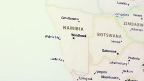 Namibia on a Map. Namibia on a political map of the world. Video defocuses showing and hiding the map stock video footage