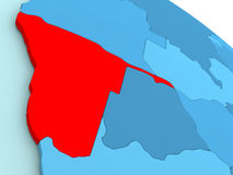 Namibia in red on blue globe Royalty Free Stock Photo