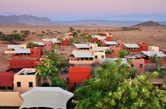 Namibia, travel Africa. Sossusvlei, Namibia - Jan 30, 2016:  Accommodation units in the Sossusvlei Lodge. View from above at sunset. The most popular place in Royalty Free Stock Photo