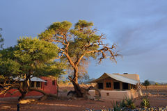 Namibia, travel Africa. SOSSUSVLEI, NAMIBIA - JAN 30, 2016: Accommodation units in the Sossusvlei Lodge at bright sunset light, the most popular place in Namib Royalty Free Stock Images