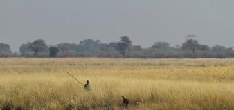 Namibian boy hunter with dog Royalty Free Stock Photo