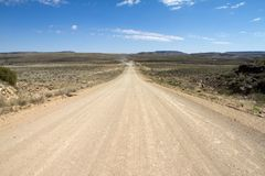 Namibian dirt road. A namibian dirt road wit a far away 4x4 travelling Royalty Free Stock Photography