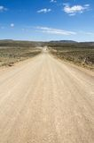 Namibian dirt road. A namibian dirt road wit a far away 4x4 travelling Royalty Free Stock Photos