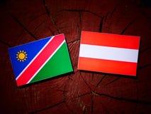 Namibian flag with Austrian flag on a tree stump  Stock Photography
