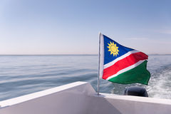 Namibian Flag Blowing in the Ocean Wind Royalty Free Stock Images