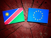 Namibian flag with EU flag on a tree stump isolated Royalty Free Stock Image