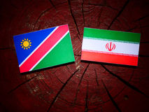 Namibian flag with Iranian flag on a tree stump isolated Stock Photography
