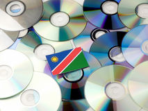 Namibian flag on top of CD and DVD pile isolated on white Stock Image