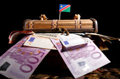 Namibian flag on top of crate. Full of money Stock Image