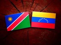 Namibian. Flag with Venezuelan flag on a tree stump isolated Stock Image