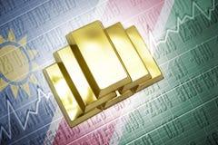 Namibian gold reserves. Shining golden bullions lie on a namibian flag background Royalty Free Stock Images