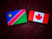 Namibijska flaga z kanadyjczyk flaga na drzewnym fiszorku odizolowywającym fotografia stock