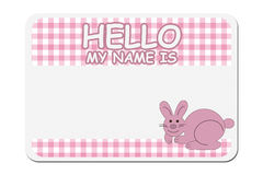 Naming your baby girl. A pink gingham hello my name is tag over white, Naming your baby girl Stock Photos