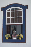 A Namoradeira, lover seraching wooden girl, on a window of Tirad Stock Image
