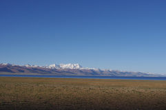 The Namtso lake and the snow mountains Stock Images