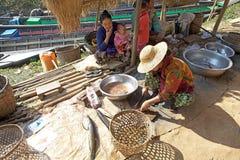 Nan Pan village market Myanmar. Burmese vendor is cutting fishes to sell at the Nan Pan village market on the Lake Inle, Shan State, Myanmar Royalty Free Stock Photo
