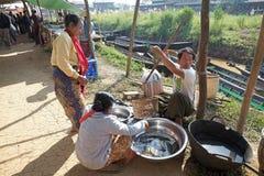 Nan Pan village market Myanmar. Burmese vendor is selling fishes at the Nan Pan village market on the Lake Inle, Shan State, Myanmar Stock Images