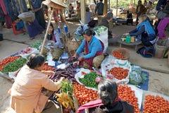 Nan Pan village market Myanmar. Burmese vendor is selling food at the Nan Pan village market on the Lake Inle, Shan State, Myanmar Royalty Free Stock Image