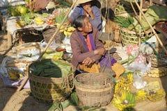 Nan Pan village market Myanmar. Burmese vendor is selling food at the Nan Pan village market on the Lake Inle, Shan State, Myanmar Royalty Free Stock Photo