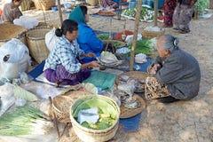 Nan Pan village market Myanmar. Burmese vendor is selling food at the Nan Pan village market on the Lake Inle, Shan State, Myanmar Stock Images