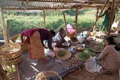 Nan Pan village market Myanmar. Burmese vendor is selling food at the Nan Pan village market on the Lake Inle, Shan State, Myanmar Stock Photo