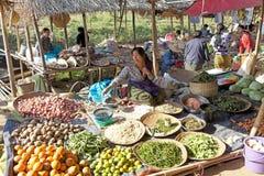 Nan Pan village market Myanmar. Burmese vendor is selling food at the Nan Pan village market on the Lake Inle, Shan State, Myanmar Stock Image
