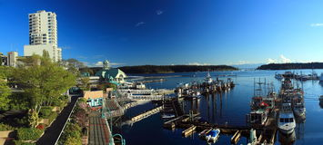 Nanaimo Waterfront and Docks, Vancouver Island. Early morning sun shines on the peaceful docks and buildings of Nanaimo`s waterfront on Eastern Vancouver Island Royalty Free Stock Photo